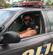 Police Officer Holding  a Radar