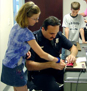 Officer Mark Arcuri Fingerprinting a Child in the Child Safety Fingerprinting Program